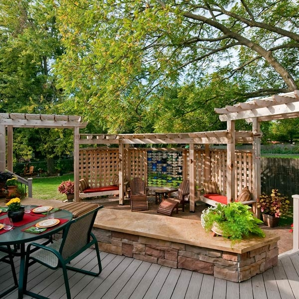 This playful and unique outdoor living space literally blends in with the home's wooded back yard
