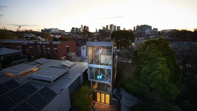 A unique design feature of the space is the water tanks that hug two sides  of the home