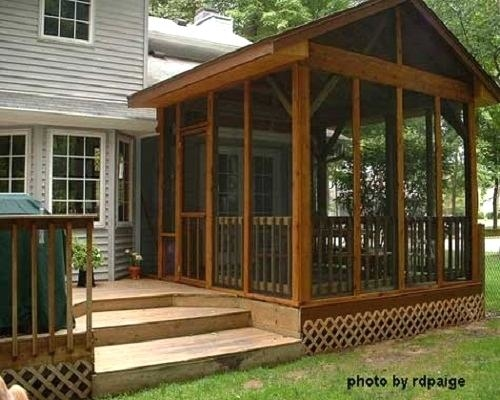 A small extension off this screened porch contains a captured doorway leading out onto the adjacent deck