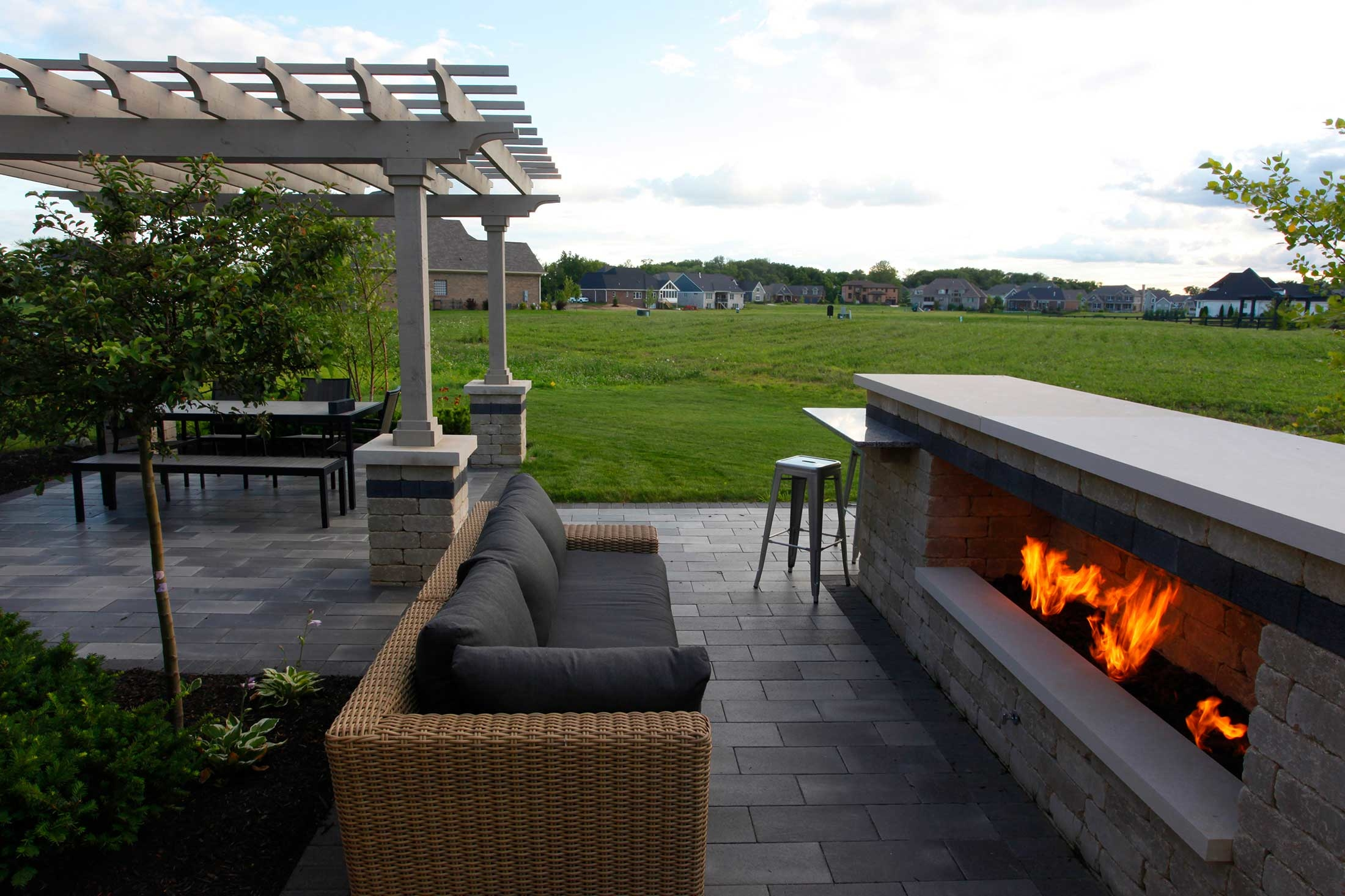This multifunctional outdoor living space features zones for living, dining, cooking and entertaining