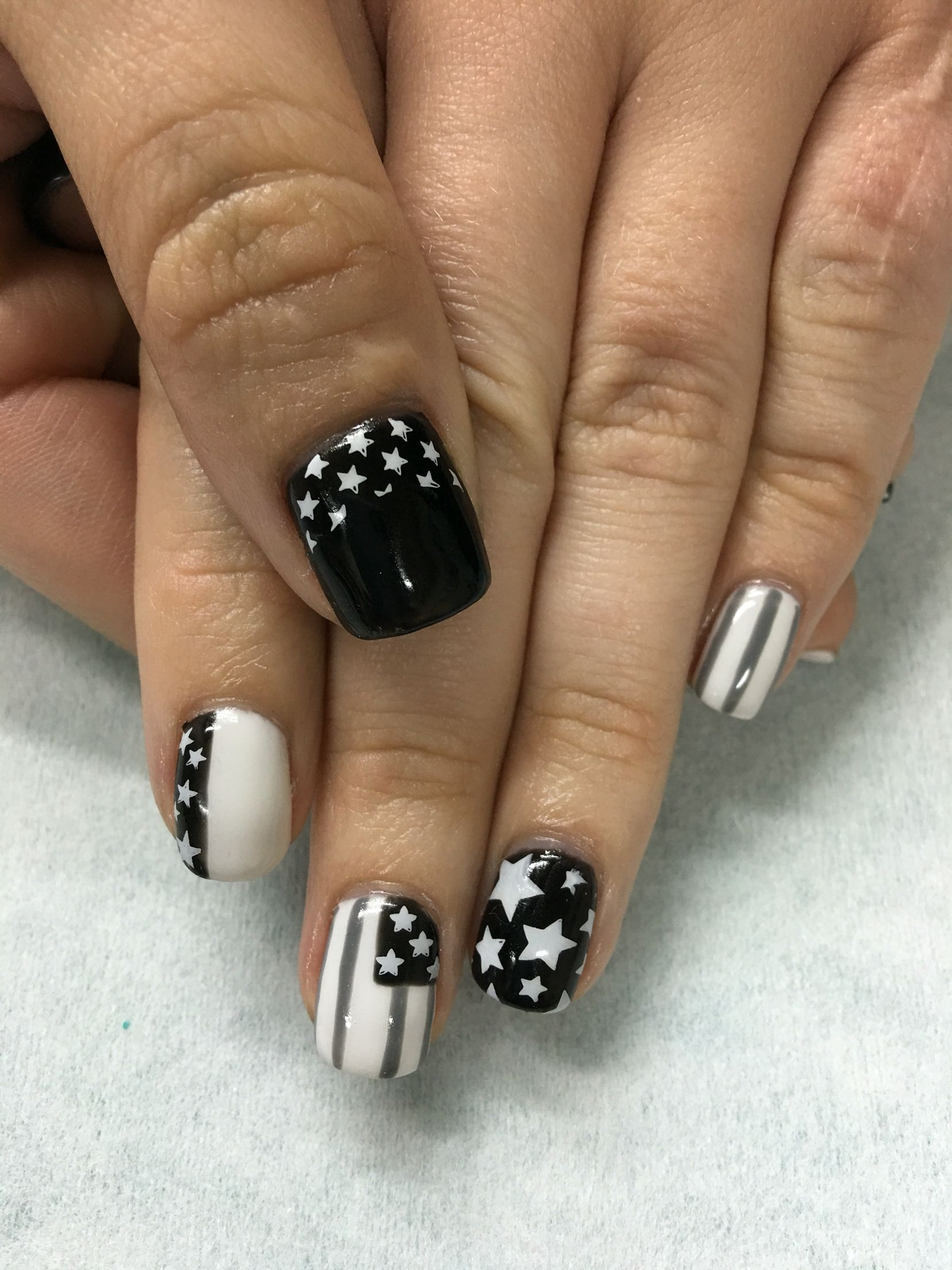 Super short nail design with black and gray gel colors with Swarovski black diamonds