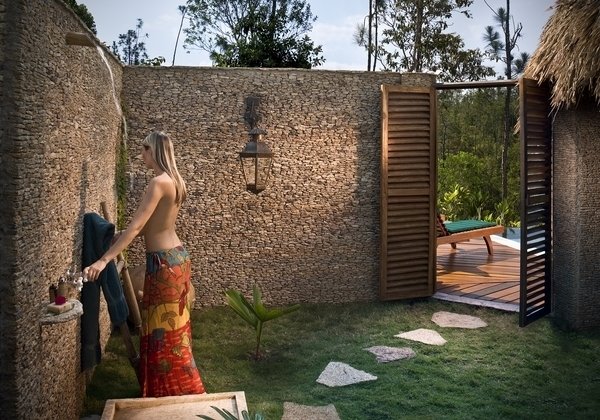 Tropical indoor and outdoor bathroom combo with outdoor shower area in private courtyard