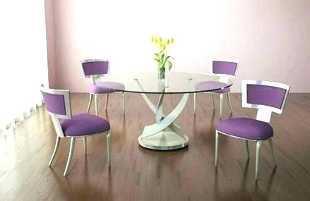 Interior of light dining room decorated with lilac flowers