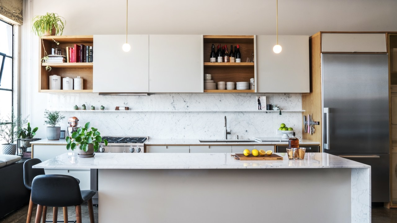 Even small  kitchens deserve a center counter—scale yours down to fit the space