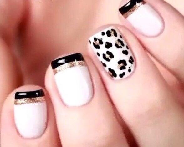 gleaming black gel nails and nail polish black nail polish gel polish  glitter nude triangle blouse
