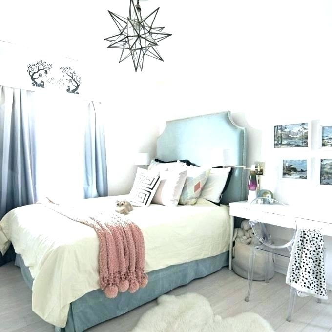boho style room, with a woven, pale beige swing, and a bed in Teenage Girl  Room Ideas