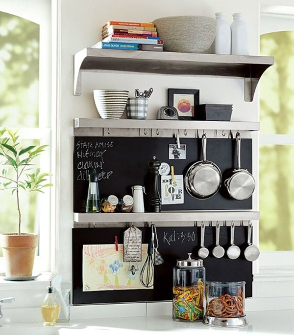 A small shelf that displays knickknacks elsewhere in the house can also  work in the kitchen to display dishware, providing a handy arrangement for  items
